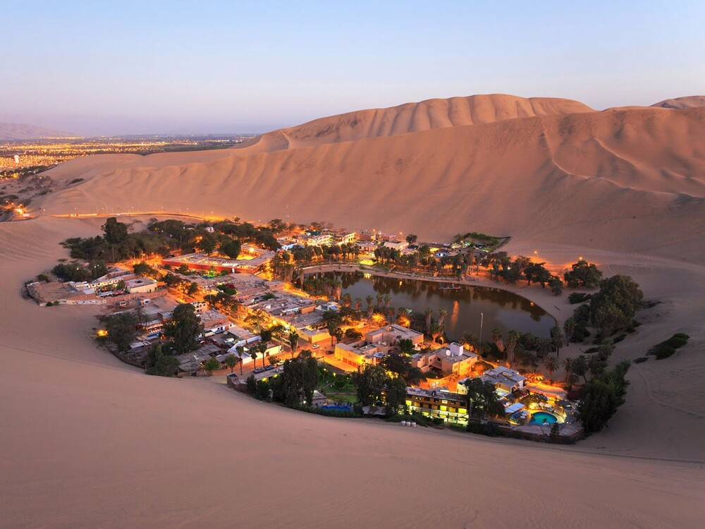 https://www.lifo.gr/sites/default/files/styles/free_height_medium/public/articles/2021-03-12/huacachina-is-a-desert-oasis-located-five-hours-south-of-lima-per.jpg?itok=LW6c70vE